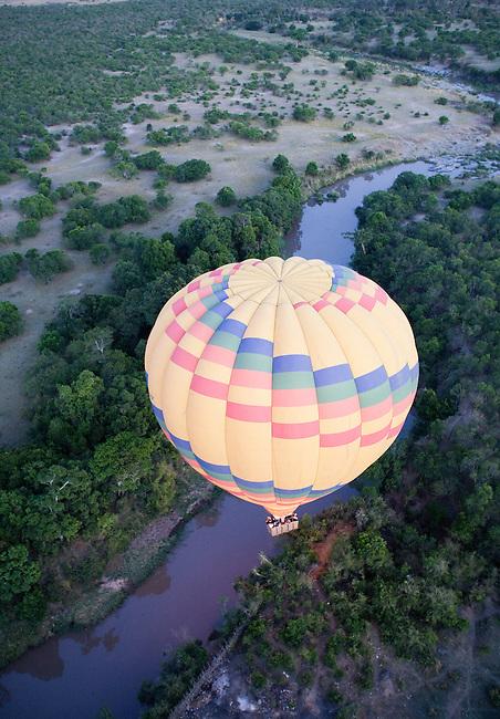 Africa, Kenya, Masai Mara. Tourists ballooning over the Talek river.