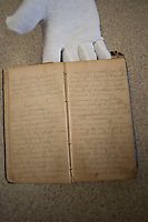 NWA Media/Spencer Tirey - Pages from a diary that describes the battle at Pea Ridge during the civil war is shown Monday, Dec. 8, 2104 at the National Military Park. The diary was recently donated to the park.