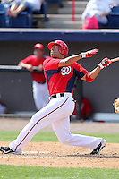 Washington Nationals Jerry Hairston #15 at bat during a spring training game against the Florida Marlins at Spacecoast Stadium on March 27, 2011 in Melbourne, Florida.  Photo By Mike Janes/Four Seam Images
