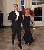 Mark and Tiffany Cuban arrive at the State Dinner for China's President President Xi and Madame Peng Liyuan at the White House in Washington, DC for an official State Visit Friday, September 25, 2015. Credit: Chris Kleponis / CNP