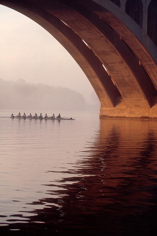 Rowing, Washington DC, Georgetown women's crew beneath the Key Bridge, Potomac River, District of Columbia, Virginia, North America, USA.