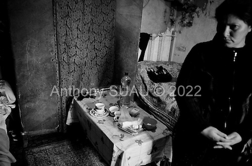 Bibi Heybat, Azerbaijan December 14, 2006<br /> <br /> Gulsham Papakhova, 35 prepares medicine in her one room house for her ill 13 year old son Roma. Just a few meters from the British Petroleum's massive multi-billion dollar off-shore platform is being built on shore.  Bibi Heybat is one of the poorest districts near Baku. Most of the residents are refugees from Nagorno-Karabakh region settled here during the war.