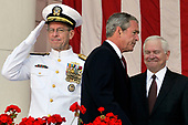 Chairman of the Joint Chiefs of Staff, United States Navy Admiral Mike Mullen, left, and US Secretary of Defense Robert Gates, right, watch as US President George W. Bush gets up to speak at Arlington National Cemetery on Memorial Day, May 26, 2008, in Arlington, Virginia. <br /> Credit: Ken Cedeno / Pool via CNP