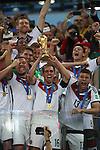 13.07.2014, Estadio do Maracana, Rio De Janeiro, WM 2014, Finale, GERMANY (GER) vs. ARGENTINA (ARG), im Bild<br /> <br /> Jubel mit Pokal<br /> Philipp Lahm (DFB), Thomas Mueller (DFB), Lukas Podolski (DFB).Mesut Oezil (DFB)<br /> <br /> Foto &copy; nordphoto
