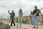 """""""Off the Wall,"""" a Los Angeles band, performs in front of servicemembers at Camp Taqaddum, Iraq, December 24, 2004. David Letterman, along with his musical director Paul Shaffer and stage manager Biff Henderson, brought the popular late night television show to the Marines, sailors and soldiers currently stationed at Camp Taqaddum, Iraq. They were followed with a performance from """"Off the Wall,"""" a southern California band, which added to the holiday festivities..Mandatory Credit: Luis R. Agostini / USMC via CNP"""