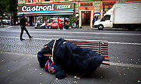 ITALY, ROME, November 5, 2011..A Homeless is seen sleeping in a Street near to the Vatican State in Rome November 4, 2011. VIEWpress /Eduardo Munoz.Italy's P.M. Berlusconi resigned on Saturday after new budget law is approved in parliament. The approval of the package will mark the final of the Berlusconi government..Local Media Report
