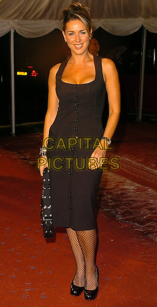 """CLAIRE SWEENEY.""""An  Audience  with  Joan  Rivers"""" .London, UK.6th November 2005.Ref: CAN.full length black corset style pencil skirt fishnet tights dress eye contact posed.www.capitalpictures.com.sales@capitalpictures.com.©Capital Pictures"""