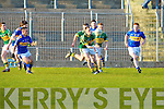Barry Dwyer(kerry) passes on the ball before John O'Callaghan Tipperary get to him and gets a helping hand from Thomas Hickey and Bill Maher(Kerry) in the Munster GAA - ESB Minor Football Championship Quarter Final 2010 in Austin Stack Park, Tralee on Wednesday evening.................................. ....