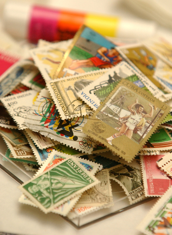 A pile of stamps sit at the National Postal Museum.  The museum held a seminar to show people procedures for locating goods stamps and how to go about saving them.