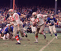 San Francisco 49ers Elmer Collett (66) lead blocks for Gary Lewis (22) during a game against the New York Giants on October 20, 1968 at Yankee Stadium in the Bronx, New York.  The  San Francisco 49ers beat the New York Giants 26-10. Elmer Collett played for 11 season with 2 different teams and was a 1-time Pro Bowler. Gary Lewis played for 7 seasons with 2 different teams.(SportPics)