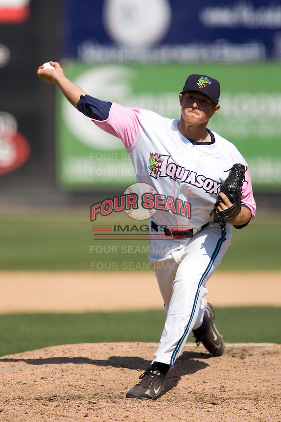 August 30, 2009: Everett AquaSox pitcher Bradley Reid toes the rubber against the Salem-Keizer Volcanes during a Northwest League game at Everett Memorial Stadium in Everett, Washington.  The AquaSox wore pink jerseys for breast cancer awareness.