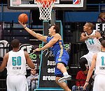 SIOUX FALLS, SD - JANUARY 15:  Taylor Griffin #12 from the Santa Cruz Warriors takes the ball to the basket between Dexter Pittman  # 50 and Mike Davis #24 from the Sioux Falls Skyforce in the first quarter of their game Tuesday night at the Sioux Falls Arena. (Photo by Dave Eggen/Inertia)