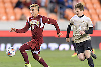Houston, TX Friday, December 9, 2016: Andre Shinyashiki (9) of the Denver Pioneers gains control of the ball with Kevin Politz (4) of the Wake Forest Demon Deacons at the NCAA Men's Soccer Semifinals at BBVA Compass Stadium in Houston Texas.