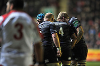 Leicester Tigers players huddle together during a break in play. Heineken Cup match, between Leicester Tigers and Ulster Rugby on January 18, 2014 at Welford Road in Leicester, England. Photo by: Patrick Khachfe / JMP