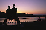 Henry Moores King and Queen sculptures silhouetted against the sunrise at Glenkiln near Dumfries Scotland UK