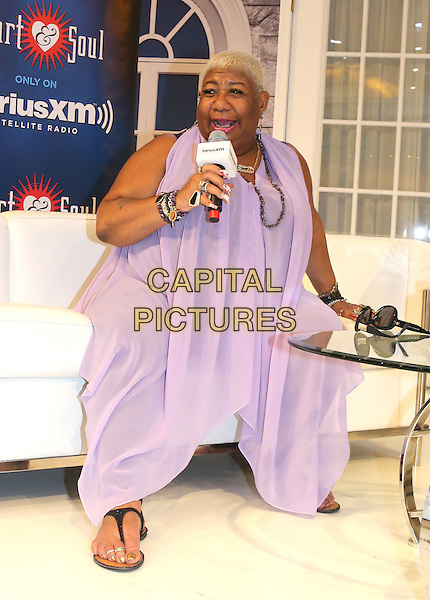 NEW ORLEANS, LA - JULY 4: Luenell at the Ford Motor Company booth at the 2015 Essence Festival at Ernest N. Morial Convention Center on July 4, 2015 in New Orleans, Louisiana.  <br /> CAP/MPI/PG<br /> &copy;PG/MediaPunch/Capital Pictures