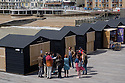 "New beach huts with stall-holders plying their wares on Hastings Pier. The pier has recently (April 2016) been reopened after extensive rebuilding owing to a fire razing it to the ground in 2010. The council compulsorily purchased it from its owners in 2012, and the so-called ""people's pier"" is now in the hands of the Hastings Pier Charity and more than 3,000 shareholders, who bought into the project at £100 a share."