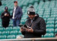 16th November 2019; Twickenham, London, England; International Rugby, Barbarians versus Fiji; Barbarians fan reading the official match programme inside Twickenham Stadium - Editorial Use