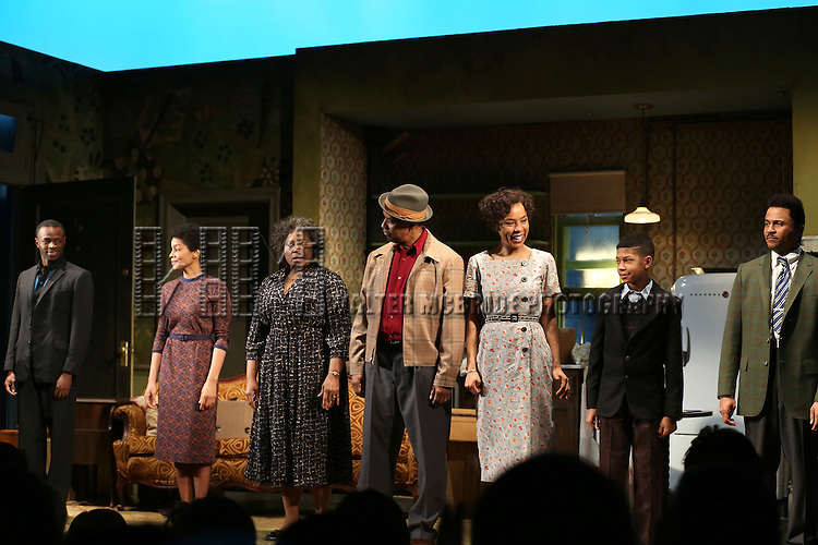 """Sean Patrick Thomas, Anika Noni Rose, LaTanya Richardson, Denzel Washington, Sophie Okonedo, Bryce Clyde Jenkins and Jason Dirden during the Broadway Opening Night Curtain Call for  """"A Raisin In The Sun""""  at the Barrymore Theatre on April 3, 2014 in New York City."""