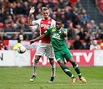 Nederland, Amsterdam, 15 april 2012.Eredivisie .Seizoen 2011-2012.Ajax-De Graafschap (3-1).Toby Alderweireld van Ajax en Rydell Poepon (r.) van De Graafschap strijden om de bal