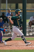 Oakland Athletics outfielder Jack Meggs (23) follows through on his swing during a Minor League Spring Training game against the Chicago Cubs at Sloan Park on March 13, 2018 in Mesa, Arizona. (Zachary Lucy/Four Seam Images)