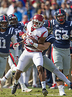 Hawgs Illustrated/BEN GOFF <br /> Josh Liddell (28), Arkansas free safety, tries to break the tackle of Jordan Wilkins (22), Ole Miss running back, as he runs back an interception in the second quarter Saturday, Oct. 28, 2017, at Vaught-Hemingway Stadium in Oxford, Miss.
