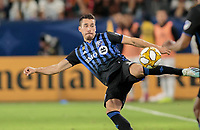 CARSON, CA - SEPTEMBER 21: Daniel Lovitz #3 of the Montreal Impact takes a swipe at the ball during a game between Montreal Impact and Los Angeles Galaxy at Dignity Health Sports Park on September 21, 2019 in Carson, California.