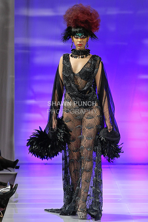 Model walks runway in an outfit from the Catalin Botezatu Fall 2013 Birds haute couture collection, during Couture Fashion Week New York Fall 2013, on February 15, 2013.