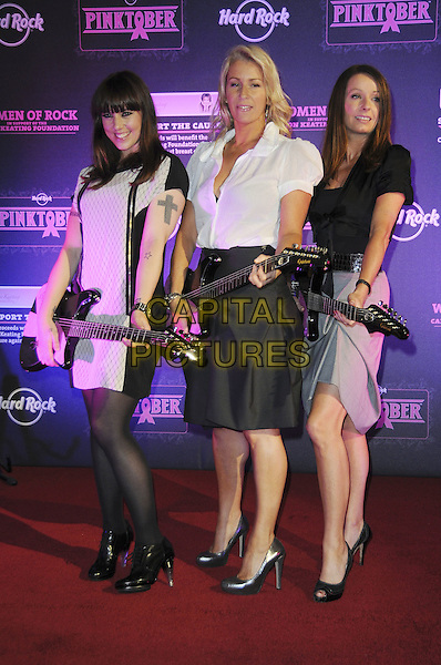 KEREN WOODWARD, SARA DALLIN,  MELANIE CHISHOLM .The PINKTOBER Concert launch, Hard Rock Cafe, Piccadilly, London, England..September 7th, 2009.mel c karen sarah full length grey gray guitar tights skirt black white dress shirt jacket .CAP/CAS.©Bob Cass/Capital Pictures.