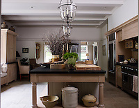 A massive kitchen island with a soapstone worktop dominates the stone-flagged kitchen