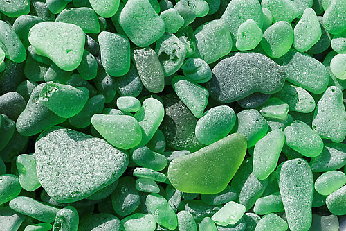 Weathered emerald green sea glass found at North Beach, Port Townsend, Jefferson County, Washington State, USA