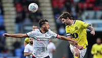 Blackburn Rovers' Charlie Mulgrew heads clear under pressure from Bolton Wanderers' Will Buckley<br /> <br /> Photographer Andrew Kearns/CameraSport<br /> <br /> The EFL Sky Bet Championship - Bolton Wanderers v Blackburn Rovers - Saturday 6th October 2018 - University of Bolton Stadium - Bolton<br /> <br /> World Copyright © 2018 CameraSport. All rights reserved. 43 Linden Ave. Countesthorpe. Leicester. England. LE8 5PG - Tel: +44 (0) 116 277 4147 - admin@camerasport.com - www.camerasport.com