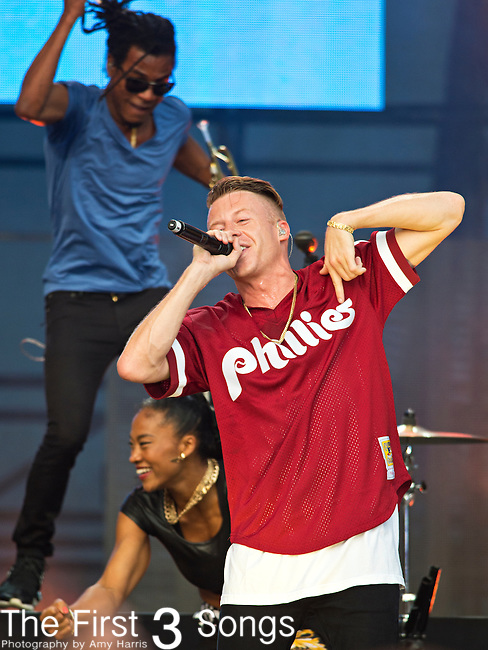 Macklemore (born Ben Haggerty) of Macklemore & Ryan Lewis performs during the 2013 Budweiser Made in America Festival in Philadelphia, Pennsylvania.