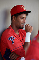 Williamsport Crosscutters catcher Nerluis Martinez (25) in the dugout during a game against the Mahoning Valley Scrappers on August 28, 2018 at BB&T Ballpark in Williamsport, Pennsylvania.  Williamsport defeated Mahoning Valley 8-0.  (Mike Janes/Four Seam Images)