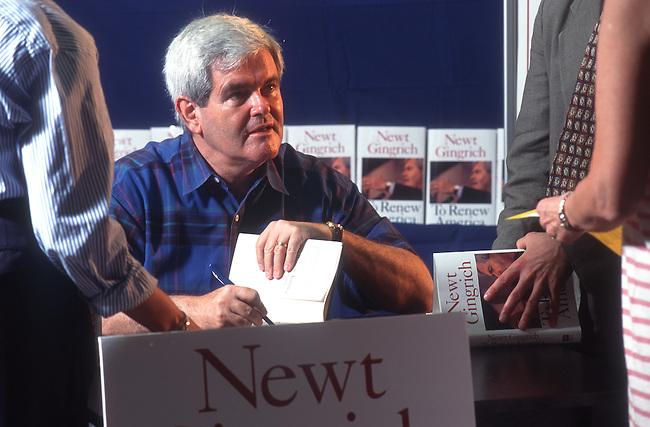 "Marietta, Ga.: Rep. Newt Gingrich (R-Ga.) signs copies of his book ""To Renew America"" on July 1, 1995 in Marietta, Ga."