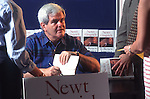 "Marietta, Ga.: Rep. Newt Gingrich (R-Ga.) signs copies of his book ""To Renew America"" on July 1, 1995 in Marietta, Ga."