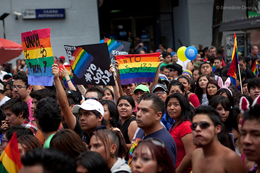 2 June 2012 - Mexico City, Mexico - People take part in the annual gay pride parade in Mexico City (known in Mexico as Marcha del orgullo LGBTQI) holding placards that say yo soy 132. Mexico's high-altitude capital city has a huge and active gay population. The increasingly popular Mexico City Gay Pride is helping to heighten the LGBT community's visibility. The LGBT community has been gaining some rights in the first years of the 21st century. On 2003, the Federal Law to Prevent and Eliminate Discrimination was passed. In November 2006, the Law for Coexistence Partnerships was enacted in the Federal District. On March 2010, Mexico became the first Latin American country to allow same-sex marriage by non-judicial means. Photo credit: Benedicte Desrus