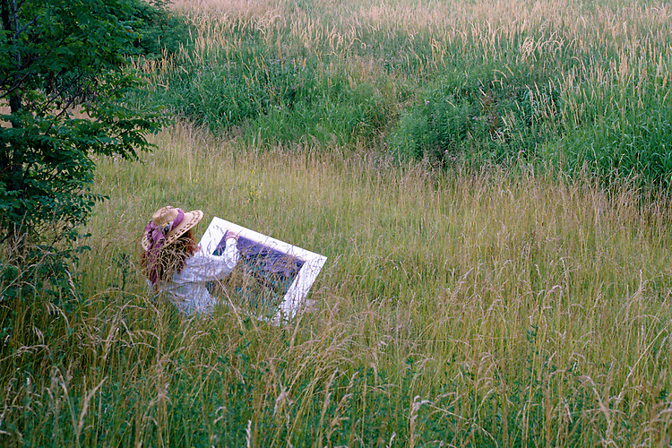 An artist draws in a field of tranquility. Location is the Cleveland, Ohio Metroparks, Rocky River Reservation