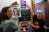 Demonstrators hold signs outside the office of Senator Susan Collins, Republican of Maine, on Capitol Hill in Washington, DC on September 26, 2018. The demonstrators are protesting against the nomination of Judge Brett Kavanaugh to be a Supreme Court Associate Justice. Credit: Alex Edelman / CNP