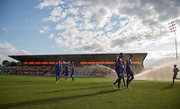 General view of team warm ups during the Friendly match between Dundee United and Queens Park Rangers at The Hive, London, England on 22 July 2015. Photo by Andy Rowland.