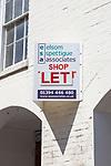 Elsom Spettigue Associates shop let estate agent sign, Woodbridge, Suffolk, England, UK