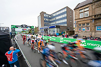 Picture by Allan McKenzie/SWpix.com - 15/05/2018 - Cycling - OVO Energy Tour Series Mens Race Round 2:Motherwell - The peloton passes under the gantry through Motherwell, OVO Energy, branding.