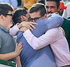 father & son bear hug - Christian and Jeremy Castro congratulating each other after Lady Haha won The Delaware Park Arabian Oaks (grade II) at Delaware Park on 8/6/16