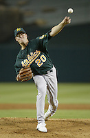 Mark Mulder of the Oakland Athletics pitches during a 2002 MLB season game against the Los Angeles Angels at Angel Stadium, in Anaheim, California. (Larry Goren/Four Seam Images)