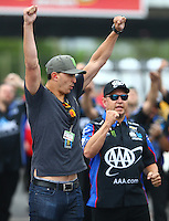 May 1, 2016; Baytown, TX, USA; Graham Rahal (left) and Robert Hight celebrate as NHRA funny car driver Courtney Force wins the final round of the Spring Nationals at Royal Purple Raceway. Mandatory Credit: Mark J. Rebilas-USA TODAY Sports