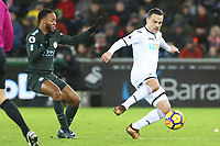 Roque Mesa of Swansea City is marked by Raheem Sterling of Manchester City during the Premier League match between Swansea City and Manchester City at the Liberty Stadium, Swansea, Wales, UK. Wednesday 13 December 2017