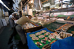 Workers lay out marie produce at a store along Harmonica Yokocho in the trendy neighborhood of Kichijoji in Musashino City, Tokyo, Japan on 16 Sept. 2012.  Photographer: Robert Gilhooly