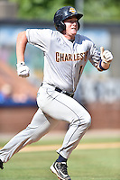 Charleston RiverDogs catcher Audie Afenir (18) runs to first during game one of a double header against the Asheville Tourists at McCormick Field on July 8, 2016 in Asheville, North Carolina. The RiverDogs defeated the Tourists 10-4 in game one. (Tony Farlow/Four Seam Images)