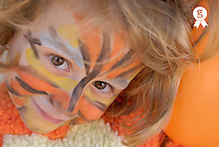 Girl (5-7) with painted face, smiling, portrait, close-up (Licence this image exclusively with Getty: http://www.gettyimages.com/detail/200476753-001 )