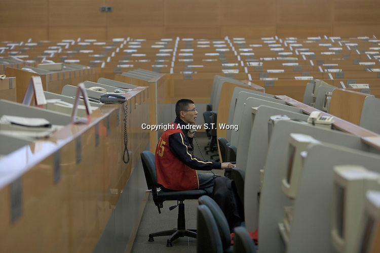 A lone dealer works at Shanghai Stock Exchange in Shanghai, China on November 9, 2009.